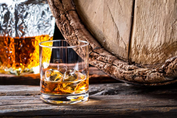 closeup of glass of good cognac in the distillery basement - whiskey stock photos and pictures