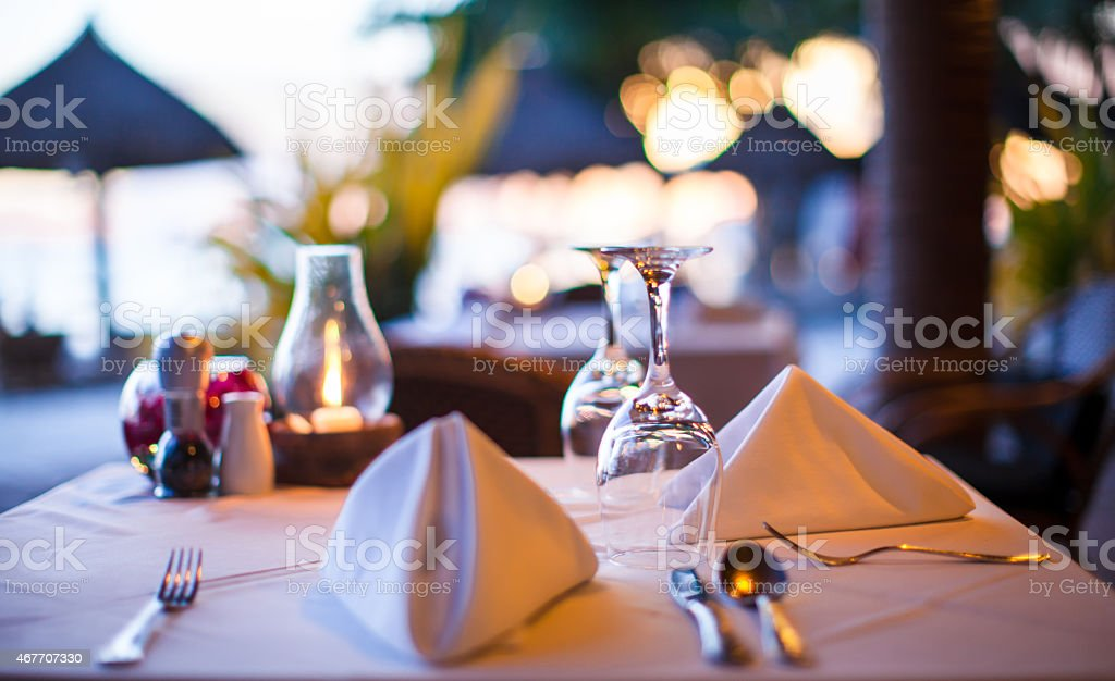 Closeup of glass with water in a restaurant in evening stock photo