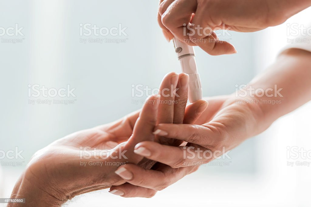 Close-up of glucose level blood test. stock photo