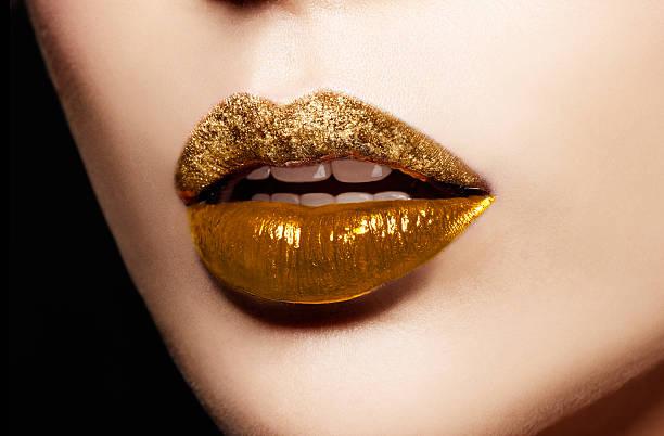 Closeup of gold artistic lips. Makeup cosmetic image. - foto de acervo