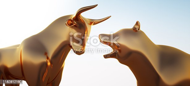 Close up of golden Bull and Bear against a bright blue Sky