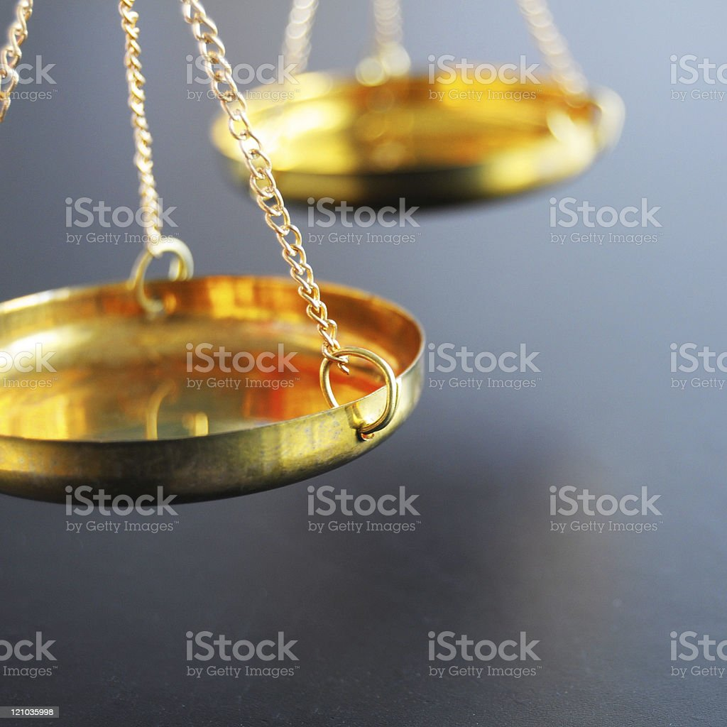 Close-up of golden colored weight scales royalty-free stock photo