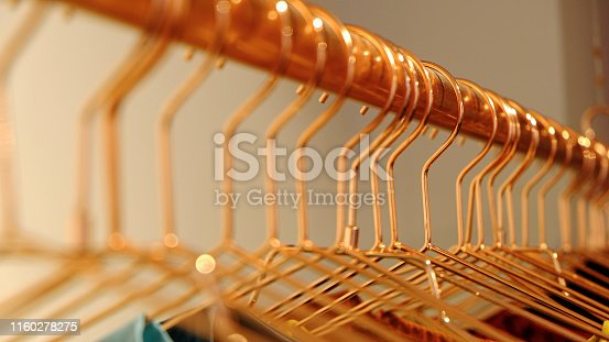 istock Close-up of golden metal clothes hanger 1160278275