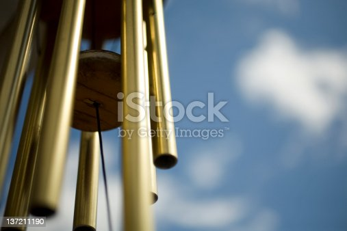 Close up shot of brass wind chimes.