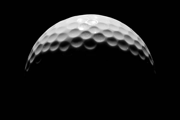 Close-up of Golf Ball on Black Background, Low Key  golf ball stock pictures, royalty-free photos & images