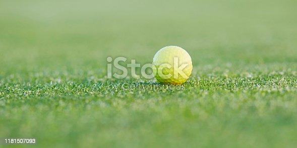 istock Closeup of golf ball on green 1181507093