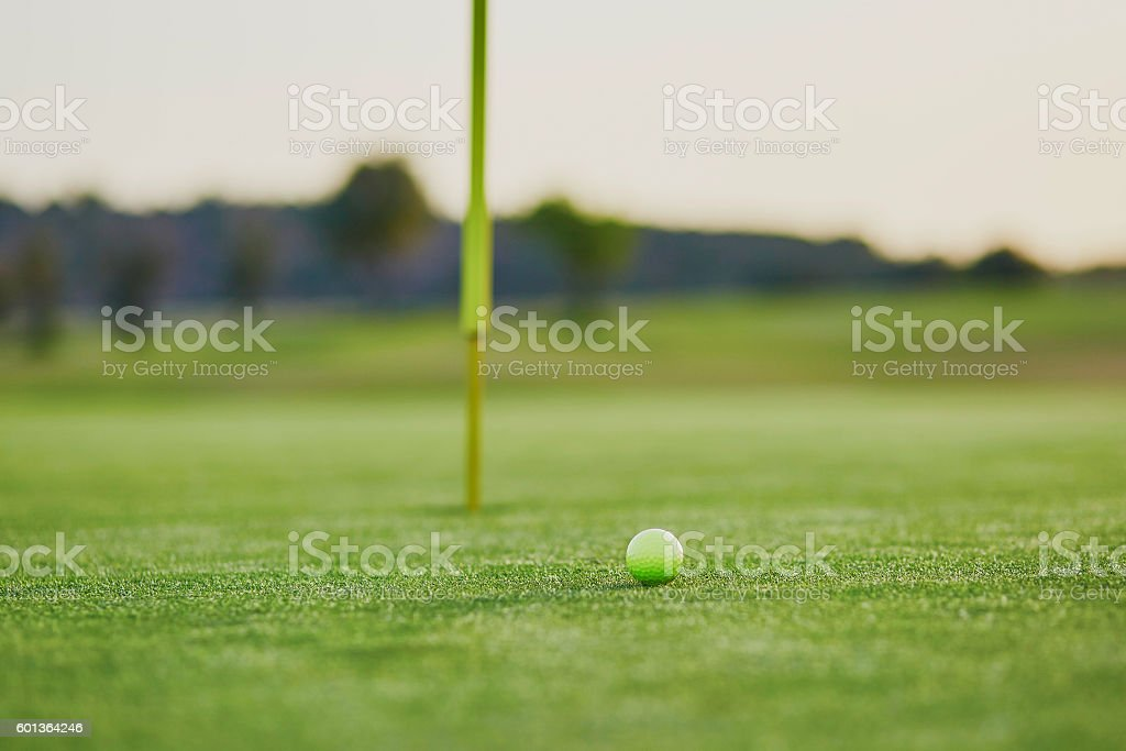 Closeup of golf ball on green stock photo