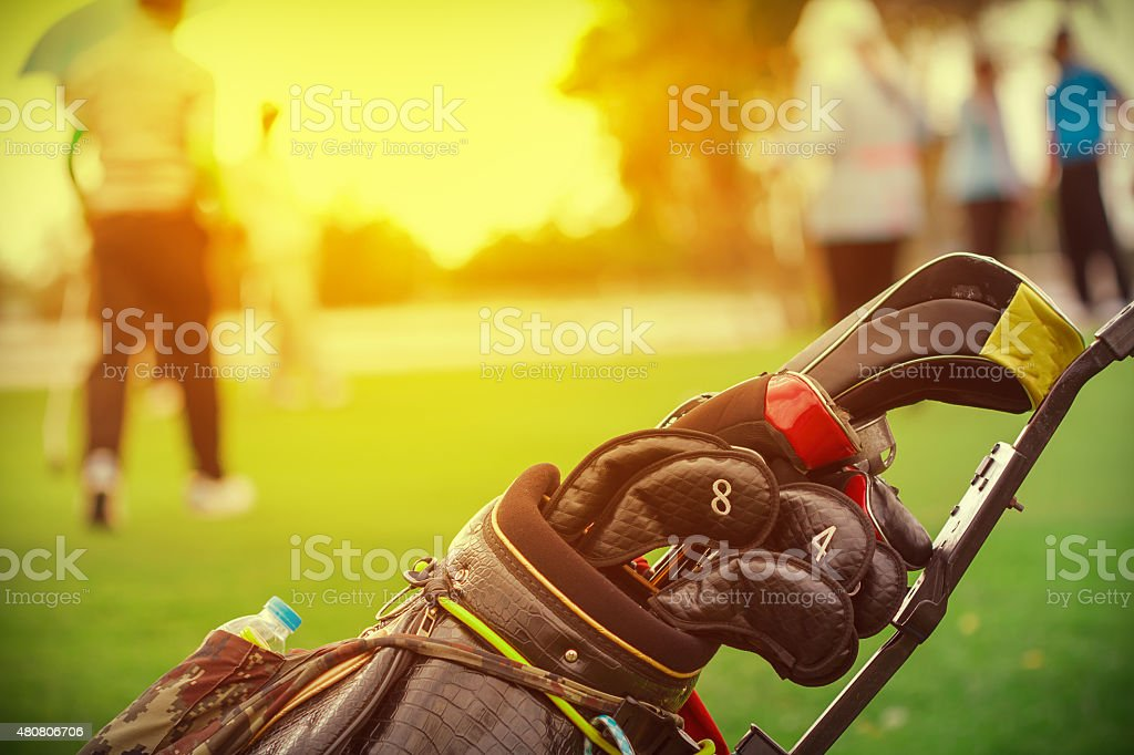closeup of golf club in bag on golfer background stock photo