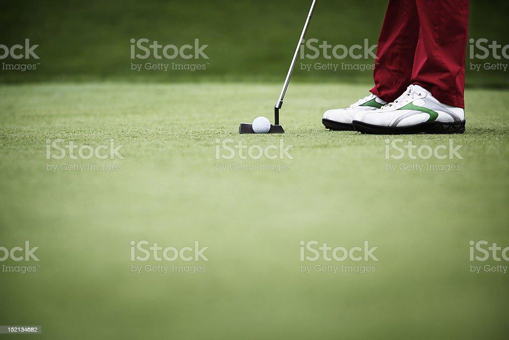 Close-up of golfer putting stock photo