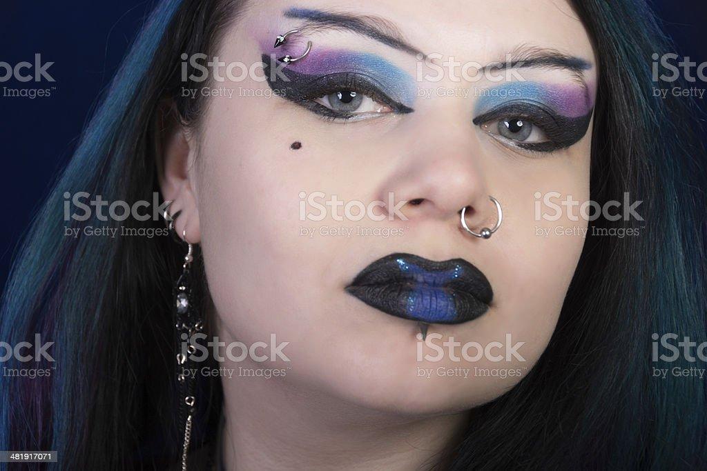 Closeup of Goth beauty in blue/black/purple makeup. stock photo