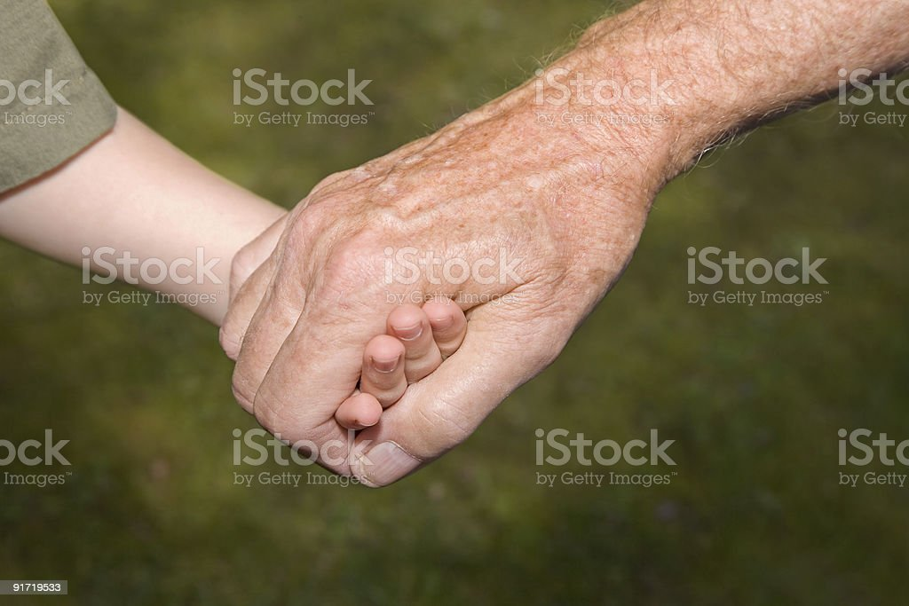 Closeup of Grandfather and Grandson Holding Hands royalty-free stock photo
