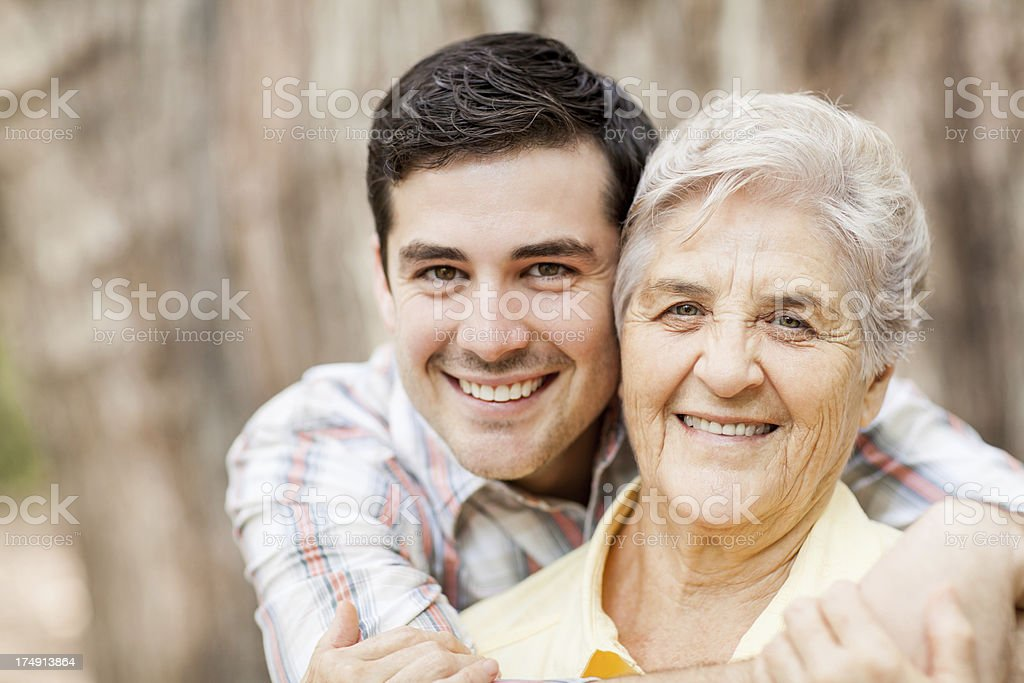 Close-up of grandson with grandmother royalty-free stock photo