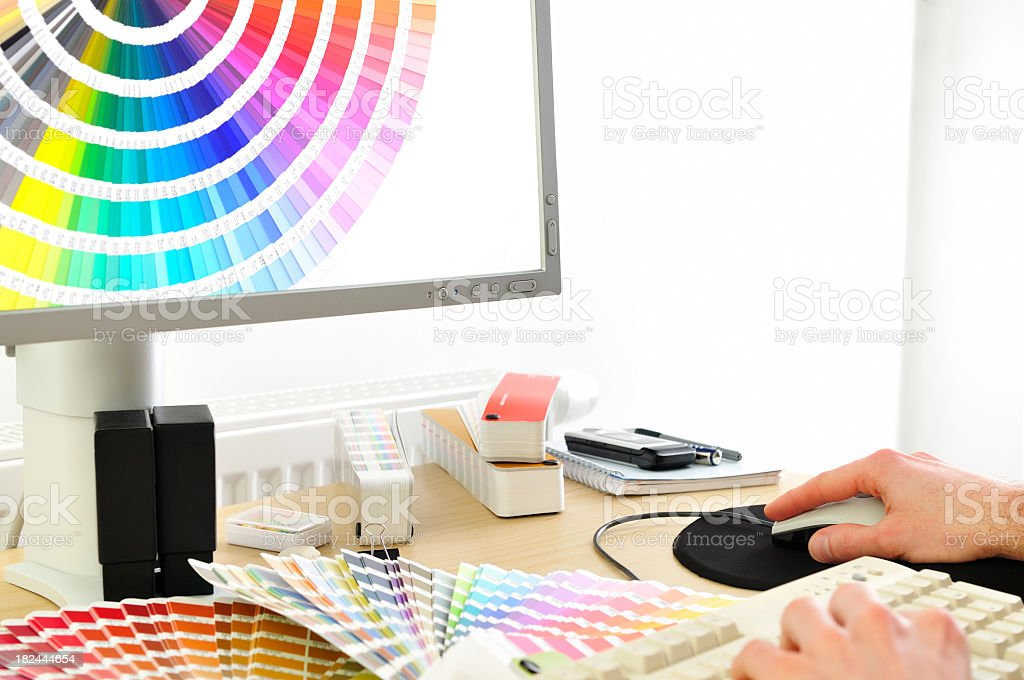 Close-up of Graphic designer choosing colour cards on lcd screen stock photo