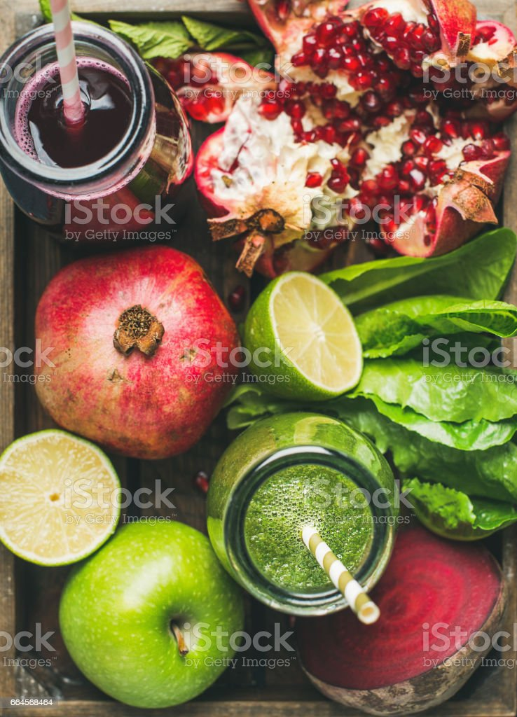 Close-up of green and purple fresh juices with fruits, vegetables stock photo