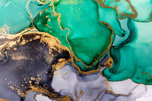 Closeup of green, black and shiny golden alcohol ink abstract texture, trendy wallpaper.