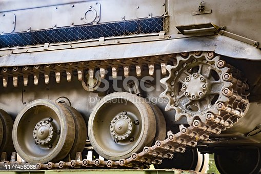 Closeup of green caterpillar track of the tank or Buk missile system standing.