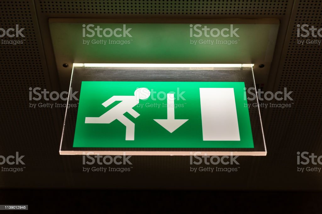 Close-up of green emergency exit light sign