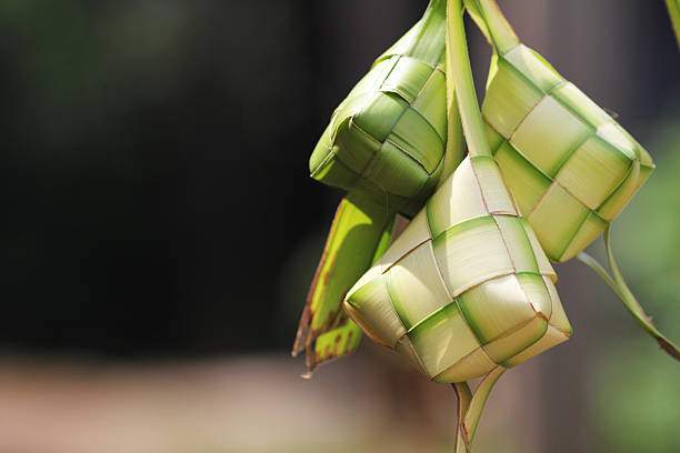 close-up of green ketupat weavings - eid stock pictures, royalty-free photos & images
