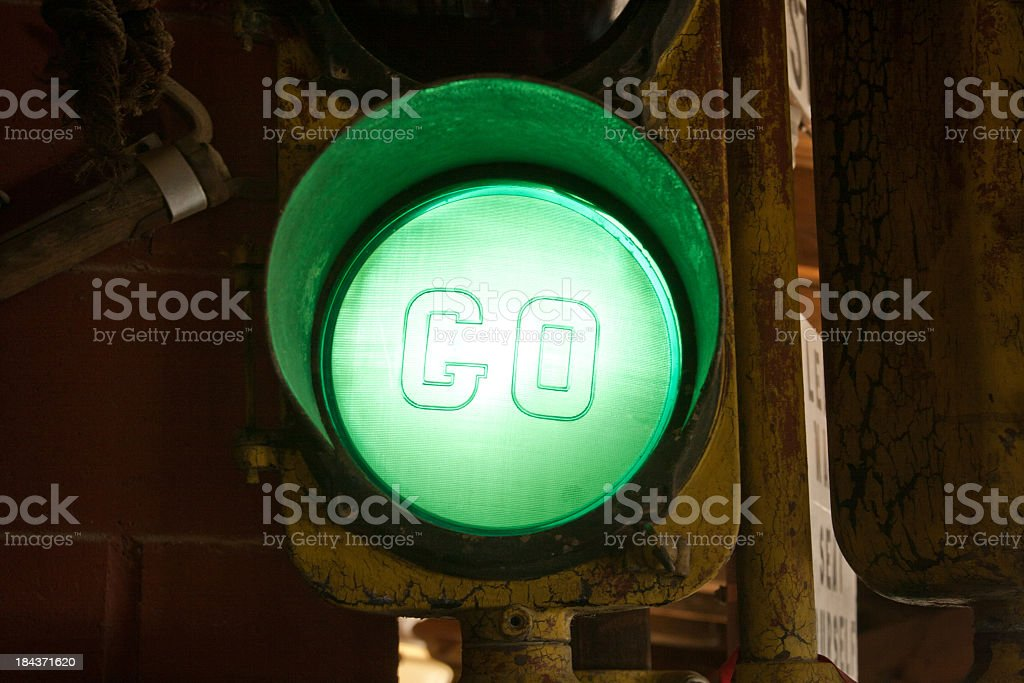 Close-up of green traffic light on post stock photo