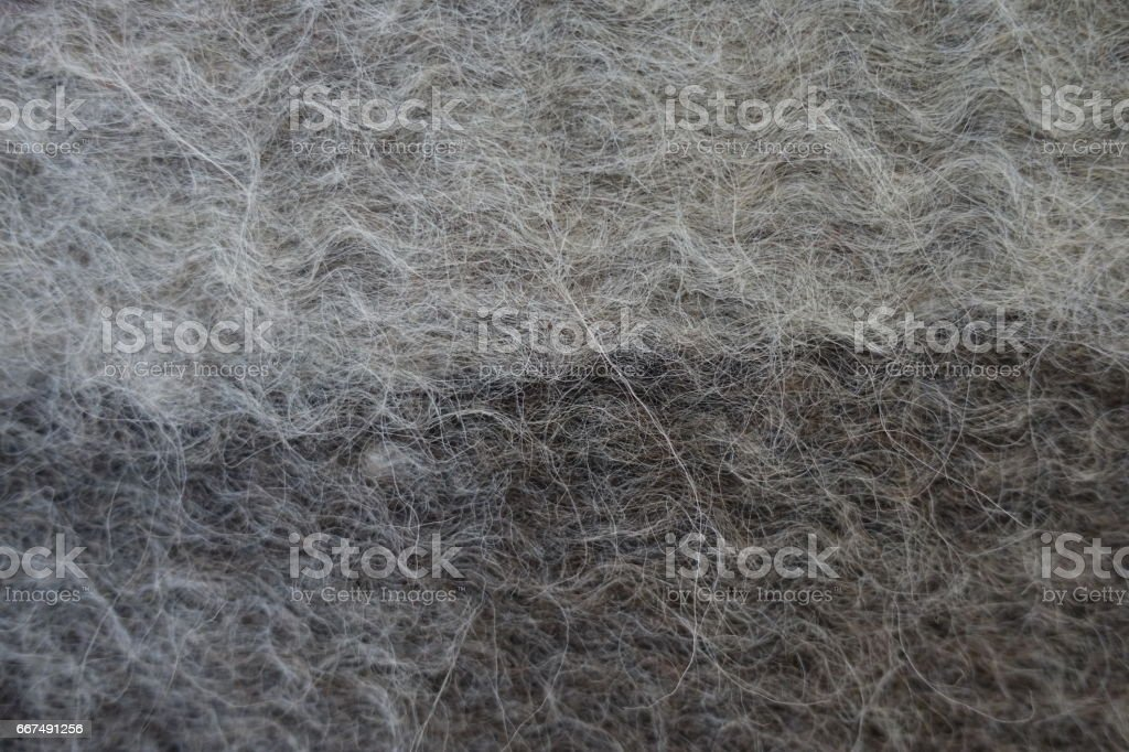 Close-up of grey handmade woollen felt blanket stock photo