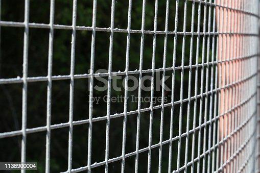 Closeup of grey mesh fence