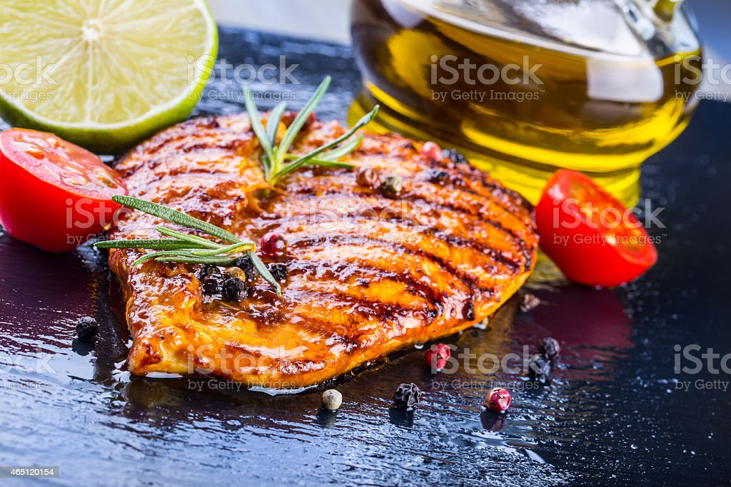 Close-up of grilled chicken breast with spices stock photo
