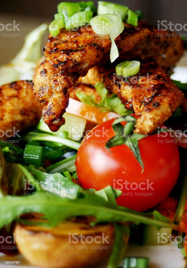 Close-up of grilled chicken salad stock photo