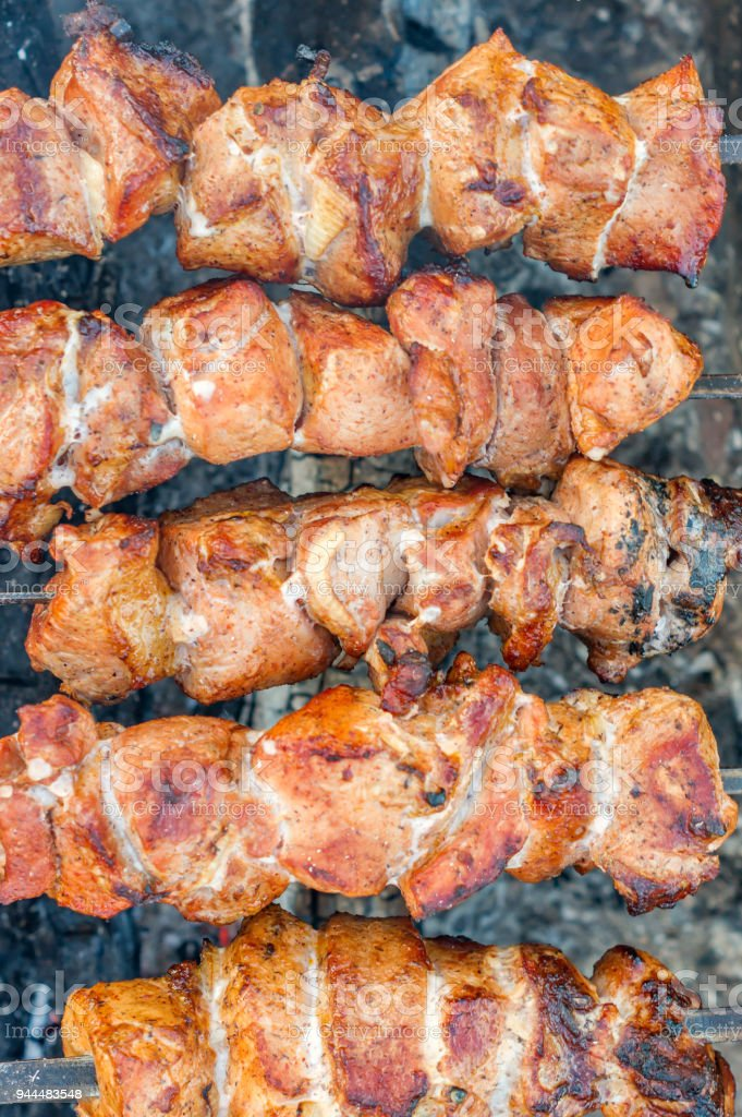 closeup of grilled meat on bbq outdoors stock photo