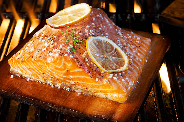 Closeup of grilled salmon and lemon stock photo