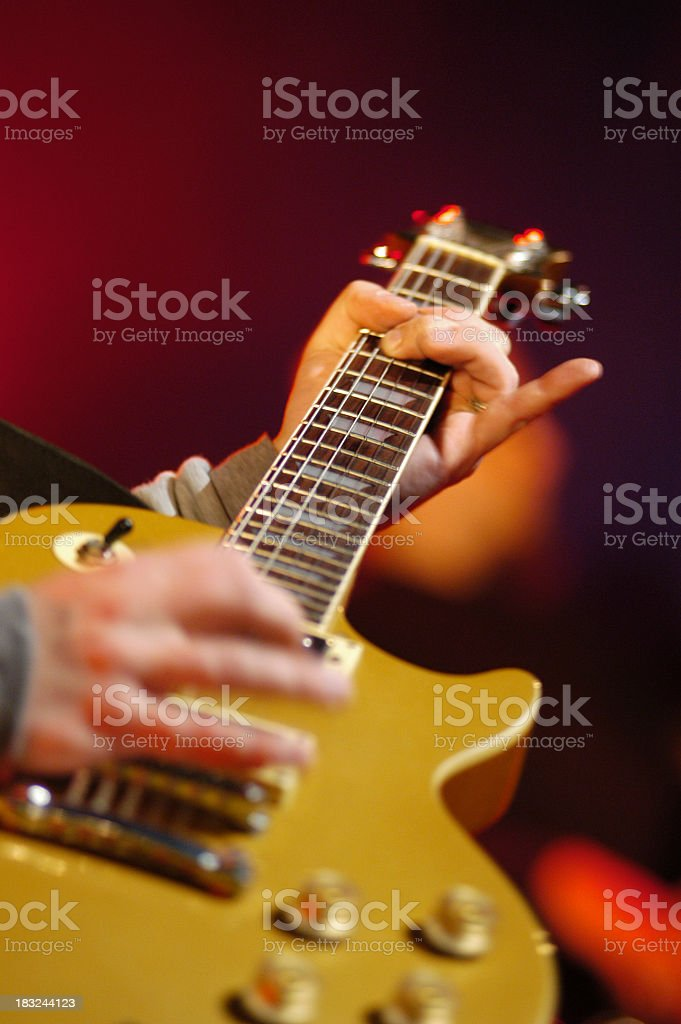 Close-up of guitar being played by a musician on red royalty-free stock photo