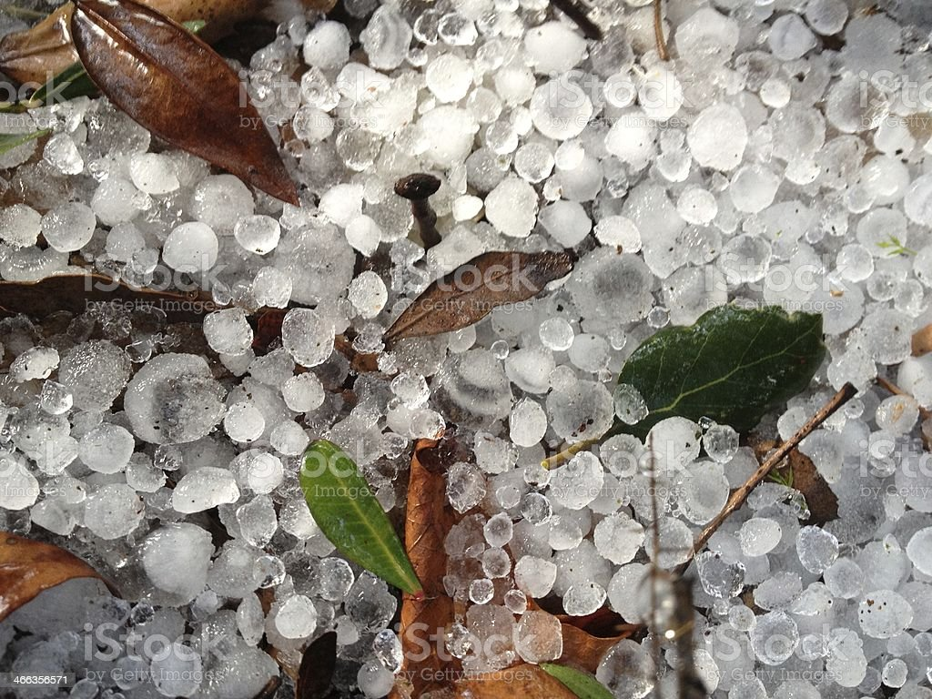 A close-up of hail particles on the ground stock photo