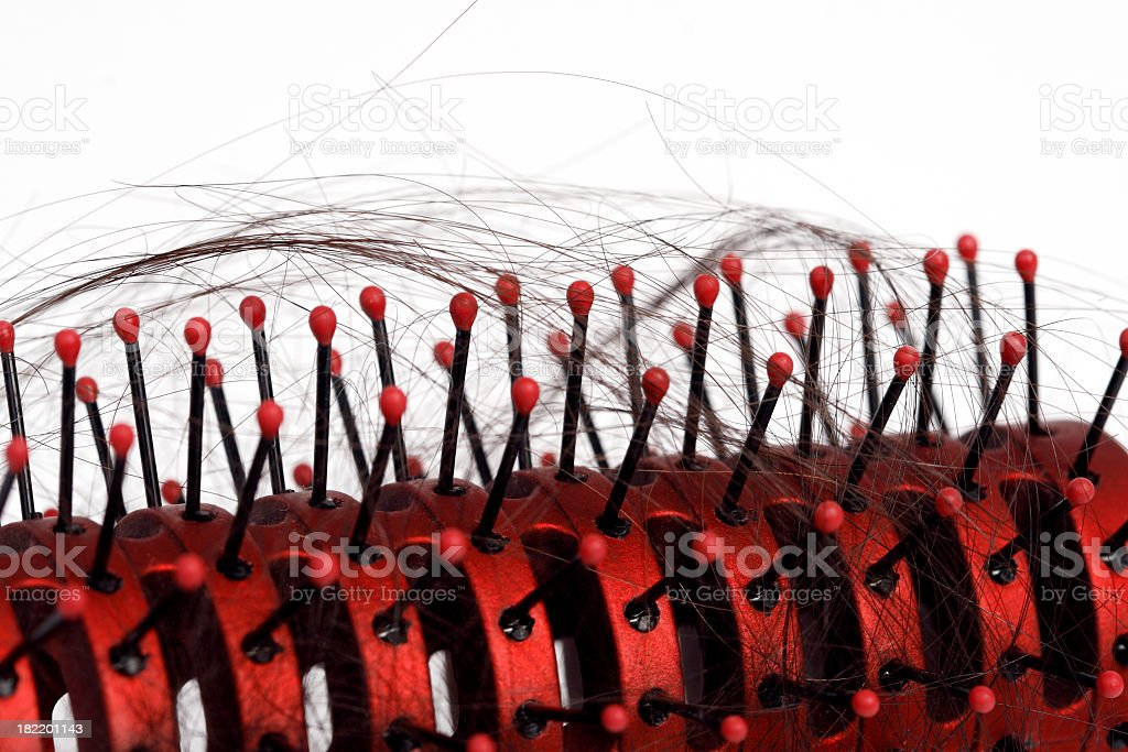 Closeup of Hairbrush with Hair Loss stock photo