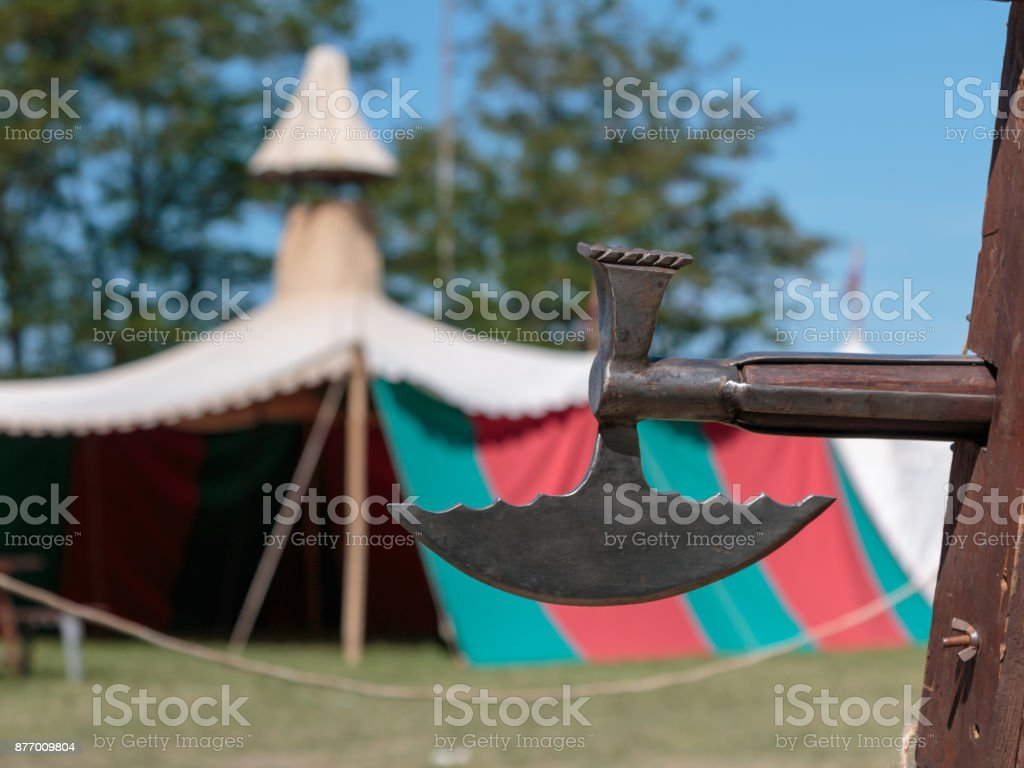 Closeup of Halberd, Medieval Pole Weapon and Tent in background stock photo