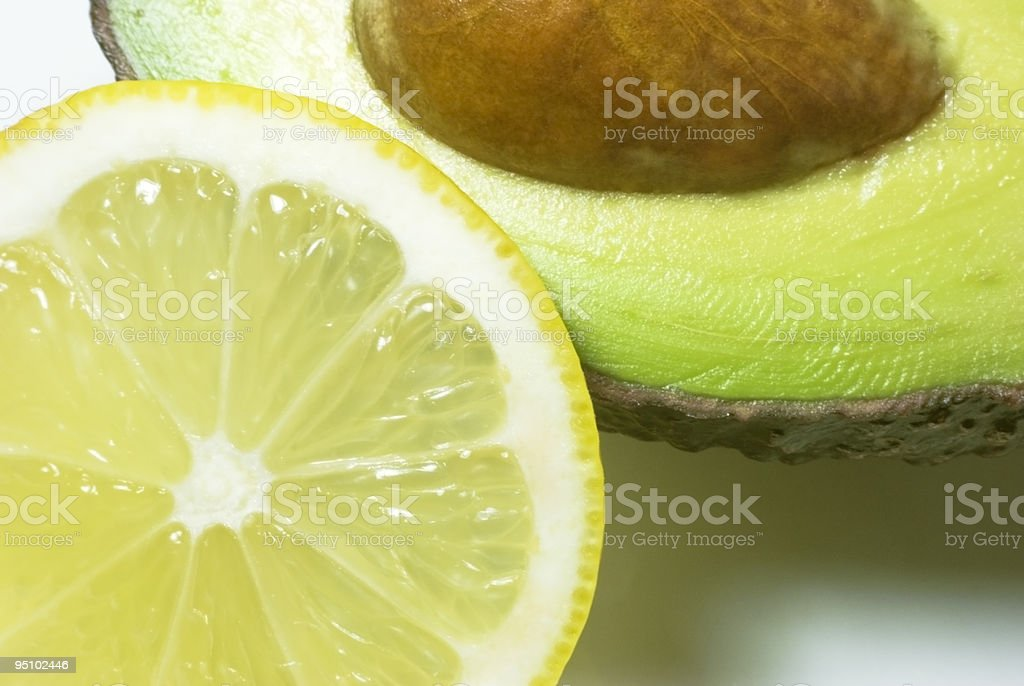 Close-up of halved lemon and avocado royalty-free stock photo