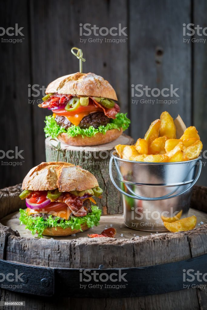 Closeup of hamburger made of bacon, tomato and beef stock photo