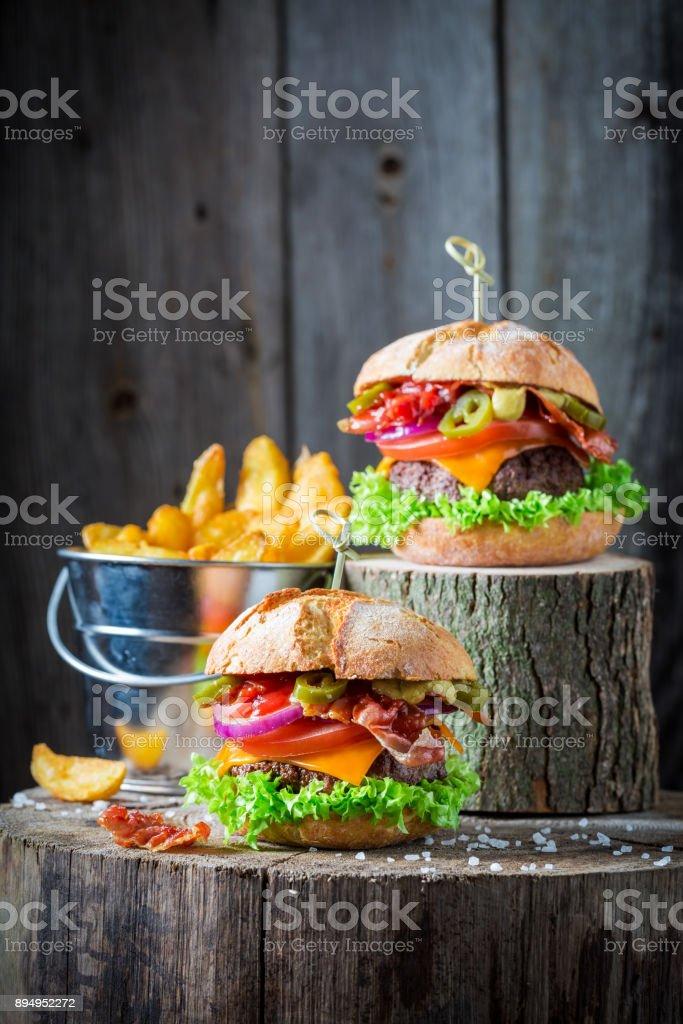 Closeup of hamburger made of onion, tomato and lettuce stock photo