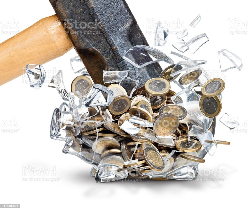 Closeup of Hammer Smashing a Clear Piggy Bank of Euros stock photo