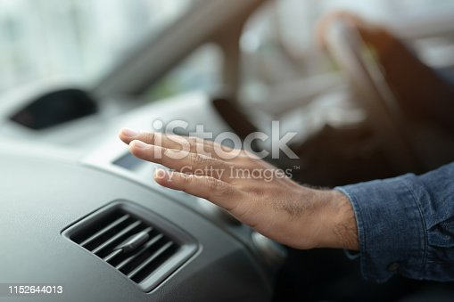 istock Closeup of hand driver man checking adjusting air from conditioning the cooling system with flow of cold air in car. Leave space for writing text. 1152644013