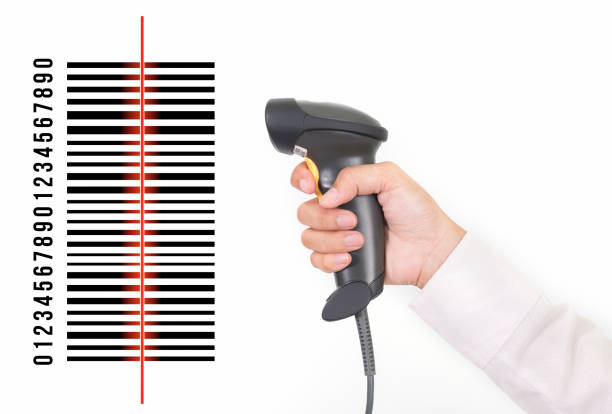 closeup of hand holding bar code scanner and scanning code on white background stock photo
