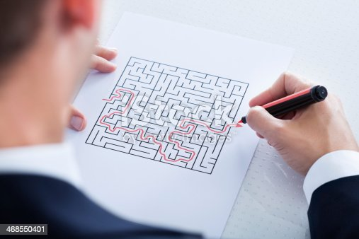 istock Close-up Of Hand Solving Puzzle 468550401