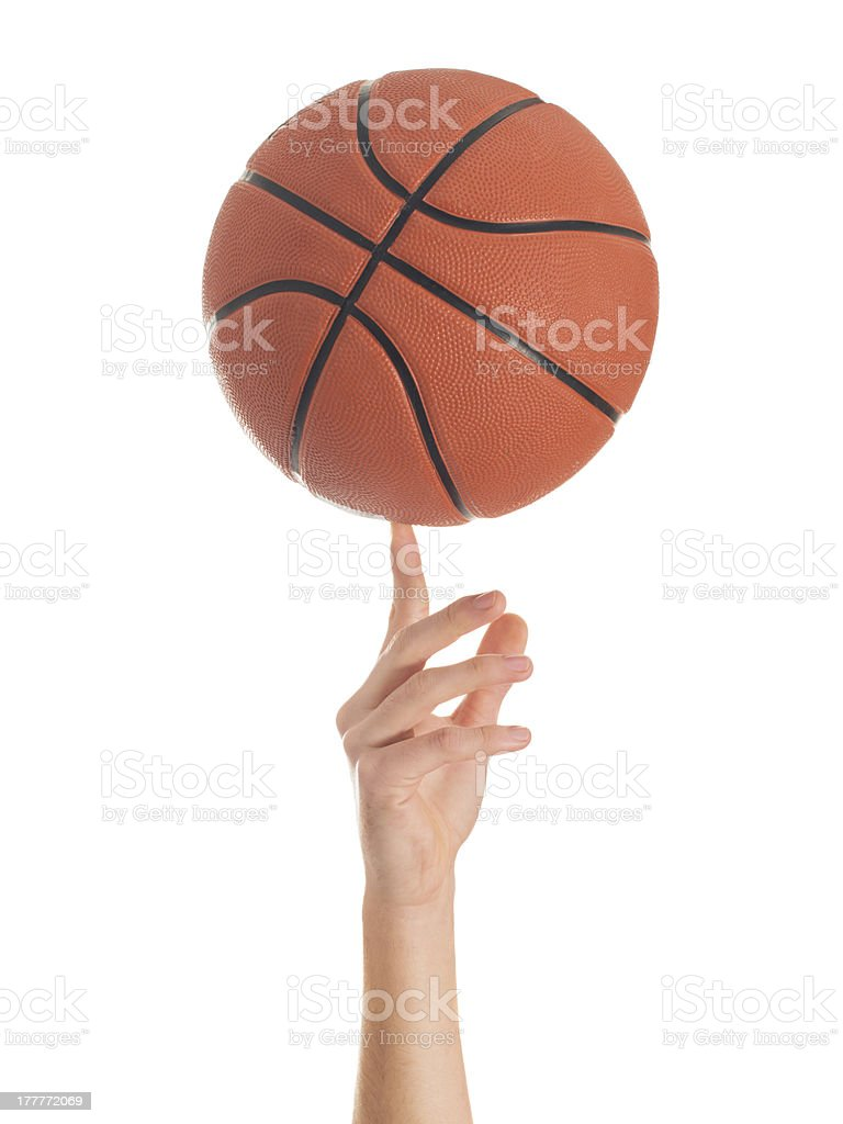 Close-up Of Hand Spinning Basket Ball stock photo
