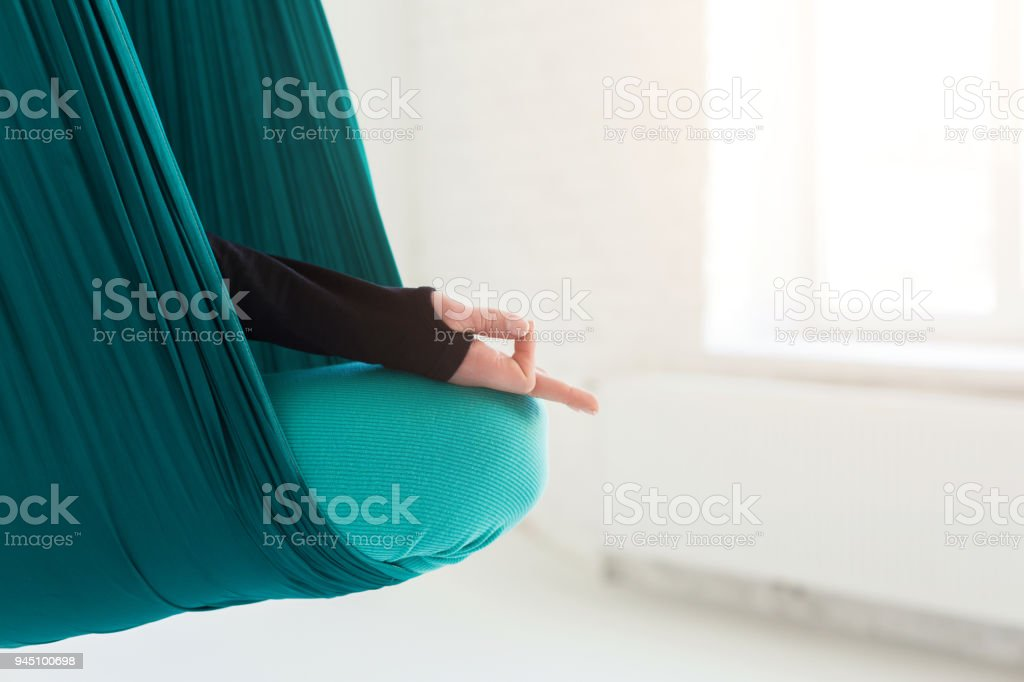 Closeup of hand, woman practicing fly yoga stock photo