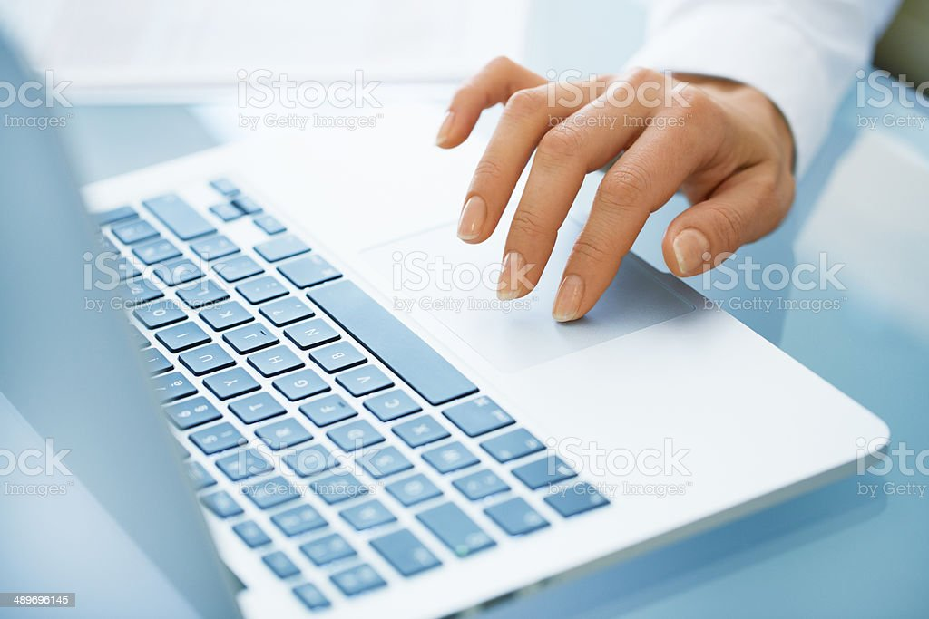 Close-up of hand woman using a laptop computer stock photo