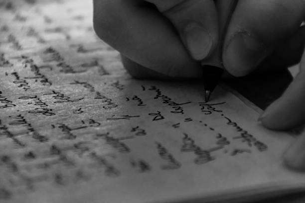 Close-Up Of Hand Writing On Paper - foto stock