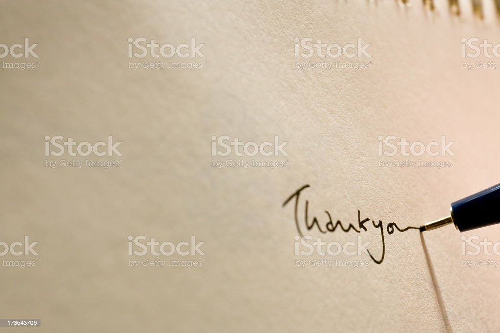 Close-up of hand written Thank you on white paper stock photo