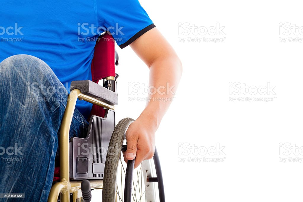 closeup of handicapped man sitting on a wheelchair stock photo