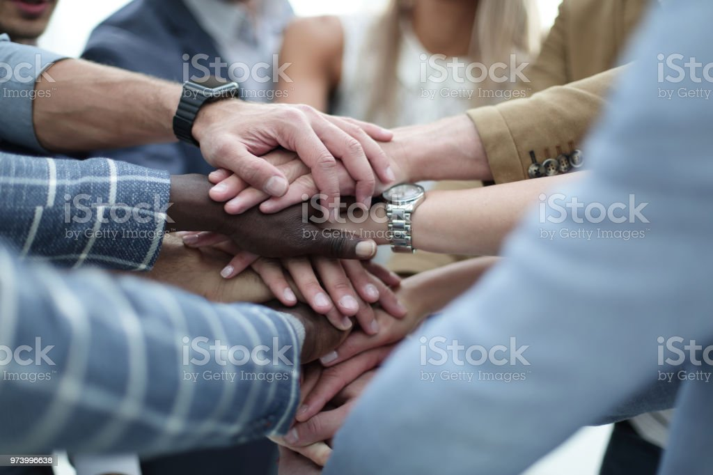 Close-Up of hands business team showing unity with putting their hands together royalty-free stock photo