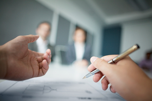istock Close-up of hands gesturing during business meeting in office 637904550
