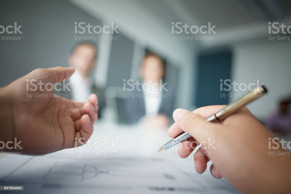 Close-up of hands gesturing during business meeting in office stock photo