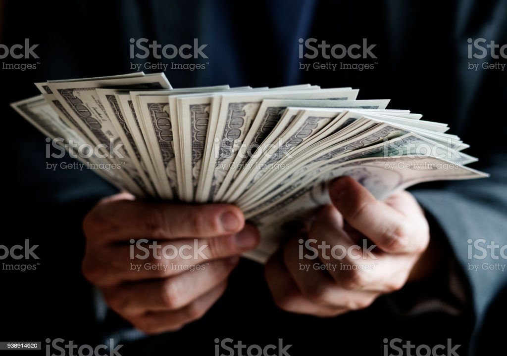 Closeup of hands holding cash stock photo